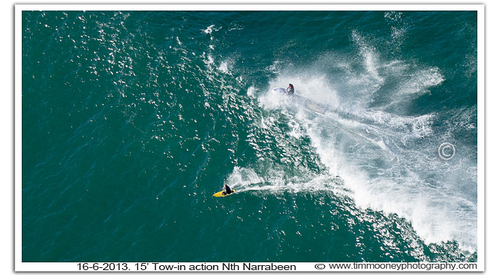 Aerial photography of tow-in-surfing amongst big surf conditions