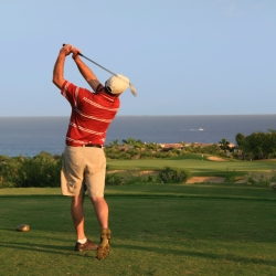Golfer taking a swing on local course