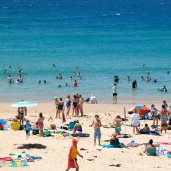 Family beach scene high summer Sydney